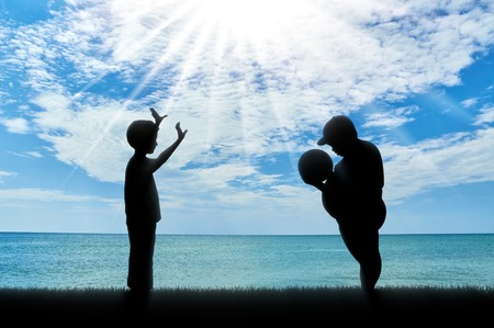 indecisive: Fat man and a normal boy, playing ball against the background of the sea. obesity concept