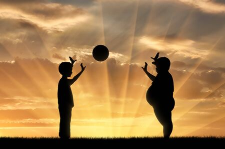 indecisive: Thick and normal boy and play ball on the background of sunset. obesity concept Stock Photo