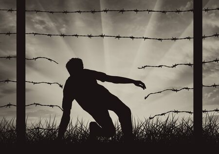 illegally: People refugee illegally cross border of another country through hole in fence. Concept refugees Stock Photo