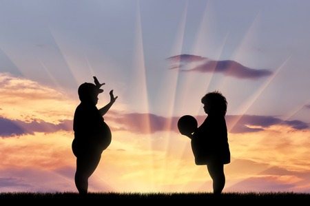 excess: Thick happy children playing ball at sunset. Concept obesity