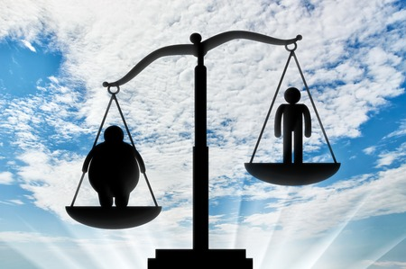 perseverance: Fat man outweighed normal on scales on background day. Concept obesity Stock Photo