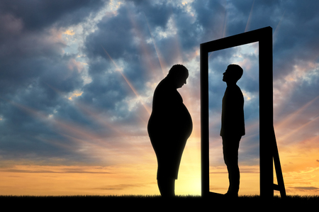 lack of confidence: Fat sad man and his reflection in the mirror of a normal man against sky. Obesity concept