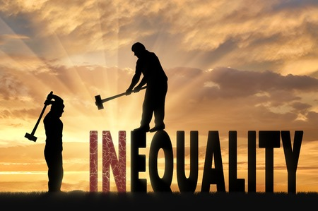 Silhouette of two men with sledgehammers smash word inequality. Social inequality and notion equality of rights Stock Photo