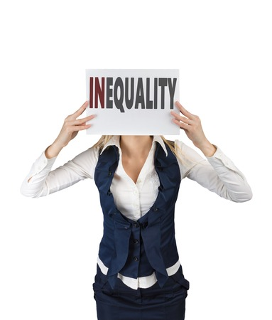 inequality: White girl holding a sheet of paper with word inequality, at face level. Social inequality concept