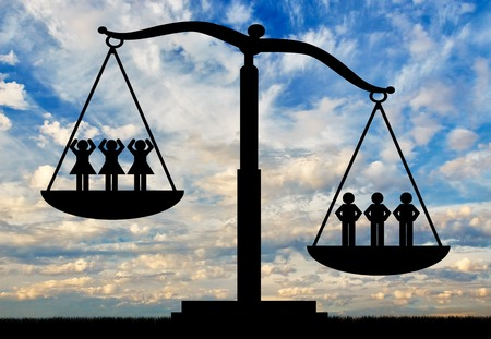 Men and women on scales. Concept of gender inequality Stockfoto