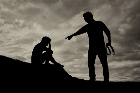 flogging: Child abuse and bullying in the family. Silhouette of crying boy afraid and aggressive drunken father with belt in his hand