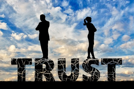 Distrust and betrayal in the family. Wife and husband are on a cracked word of trust Stock Photo
