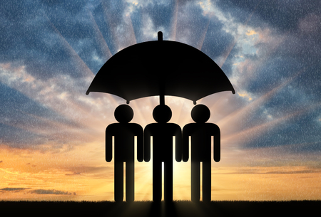Three icons of little men stand under umbrella together. Concept of social security Banco de Imagens