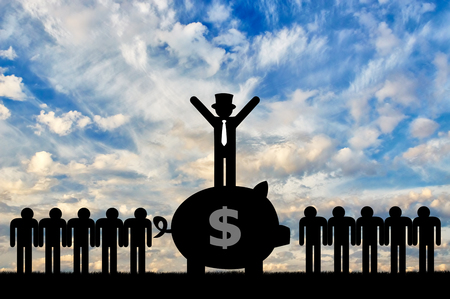 Concept of economic inequality. Rich man standing on a big piggy Bank with money next to ordinary people Stock Photo