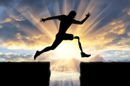Concept of disability. Man with the prosthetic leg runs and jumps across the chasm