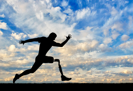 Running a disabled person with a prosthetic leg, confidently running on the ground