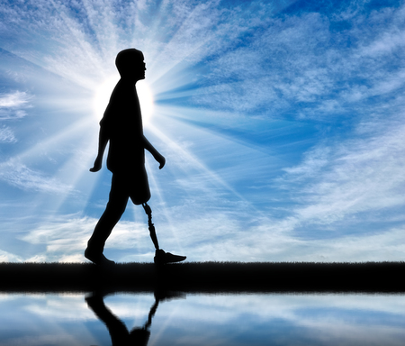 Walking disabled with a prosthetic leg against the sky and the river with its reflection