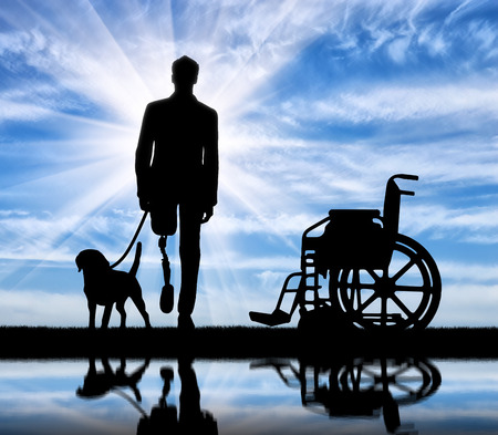 Disability and rehabilitation. Disabled man with prosthetic leg walks without a wheelchair with a dog on the river