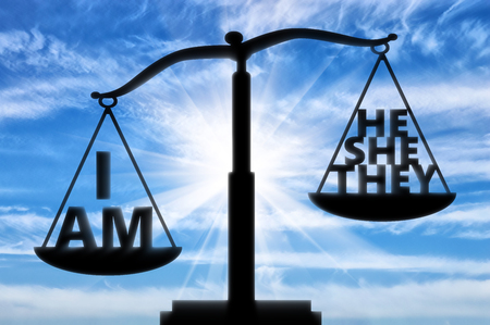 Selfish and egoist concept. Words on the scales of justice are weighted to show the concept of selfishness