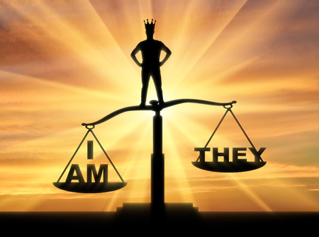 Concept of selfishness and narcissistic person. Silhouette of a man with a crown, standing on the scales of justice chooses his interests Stock Photo