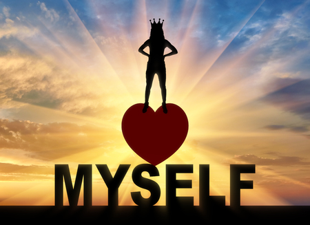 Concept of narcissism and selfishness. Silhouette of a narcissistic woman with a crown on her head. Stock Photo