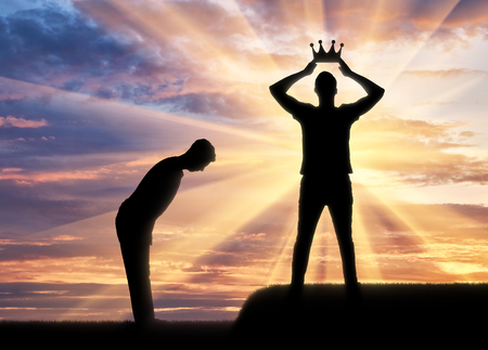 Concept of selfishness and narcissistic. Silhouette of a man dresses his crown, and a servant bows to him