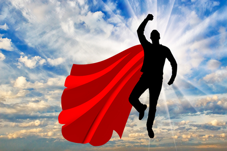 Superman businessman superhero silhouette of a superman businessman superman businessman superhero silhouette of a businessman in the image of a superman flying in publicscrutiny Images