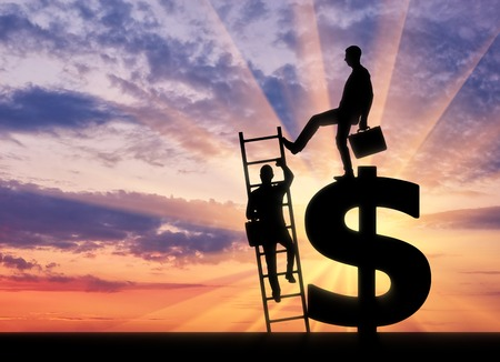 Silhouette of a businessman climbs the stairs, and another businessman standing on a dollar symbol pushes this ladder. The concept of greed and inequality Stock Photo