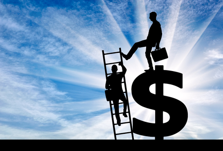 Silhouette of a businessman climbs the stairs, and another businessman standing on a dollar symbol pushes this ladder. The concept of inequality and injustice Stock Photo