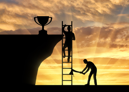A business rival cuts a ladder on which another person climbs to the trophy. The concept of business success and the envy of rival