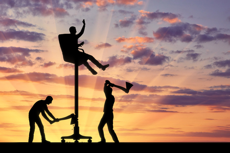 Business competitors are cutting an ax with a chair on which a businessman sits high. The concept of envy of rivals to the success of another person