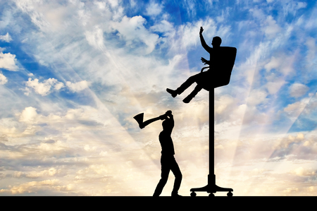 The rival is chopping an armchair on which the person sits high. The concept of a career ladder Stock Photo