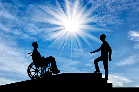 A disabled person in a wheelchair climbs up the ramp, and healthy man on the stairs. The concept of assistance and care of persons with disabilities in moving around the city Banco de Imagens