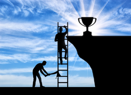 A business rival cuts a ladder on which another person climbs to the trophy. The concept of envy of the opponent to the success of another person