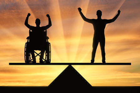 A disabled person in a wheelchair equal rights in the balance with healthy. The concept of equal rights of persons with disabilities in society
