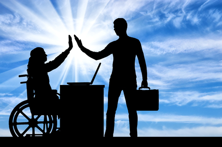 Worker woman a disabled person in a wheelchair with an employee at work. The concept of tolerance and equality for people with disabilities