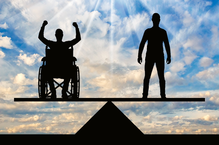 A disabled person in a wheelchair equal rights in the balance with healthy. The concept of equal rights of disabled people in society
