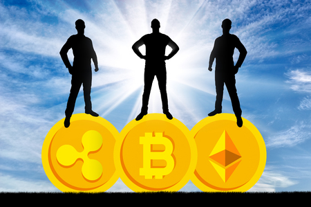 Three businessmen are standing on three coins of the crypto currency. The concept of business in the crypto currency Stock Photo