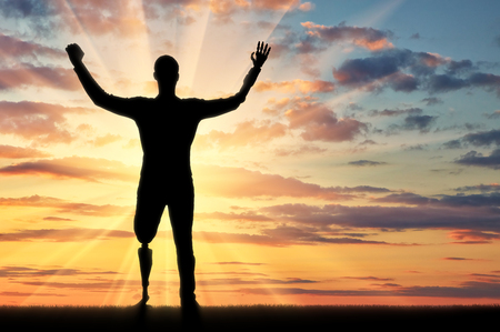 Happy silhouette of a disabled man with prosthetic arms and legs. Concept of people with disabilities with limb prostheses Stock Photo
