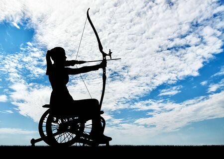 Silhouette of a disabled woman in a wheelchair engaged in sports archery. Concept of people with disabilities in sports