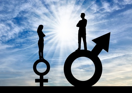 Silhouette of a big man and a small woman standing on gender symbols. The concept of gender inequality Stock Photo
