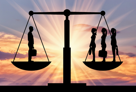 Silhouette of one man and three women on the scales of justice. The concept of gender inequality
