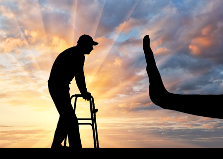 Silhouette of a man with a walker for the disabled and hand gesture stop. The concept of a social problem among disabled people