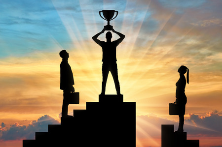 Silhouette of a male winner with a trophy on the career ladder against the background of a woman who has no chance of winning. The concept of gender inequality and discrimination Stock Photo