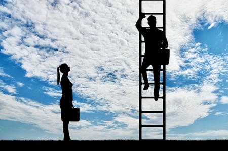 Silhouette of workers, a man climbs the career ladder instead of a woman. The concept of gender inequality and discrimination against women in their careers Stock Photo