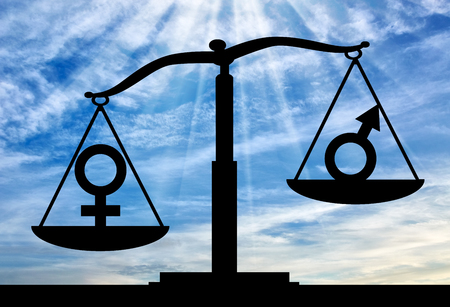 Silhouette of gender symbols on the scales of justice where the female symbol predominates. The notion of the superiority of women over men