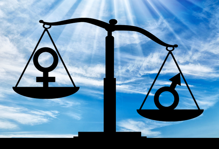 Silhouette of gender symbols on the scales of justice where the male symbol predominates. The concept of gender inequality in women Stock Photo