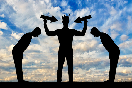 Silhouette of a selfish man with a crown on his head is trying to attract attention. Stock Photo
