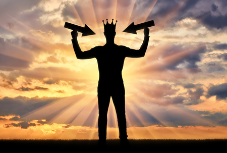 Silhouette of a man with a crown on his head tries to attract attention by holding pointer in his hands.