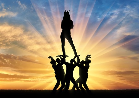 Silhouette of a woman with a crown on her head standing on the hands of men.