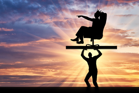 The silhouette of a selfish man with a crown on his head sitting in a chair, points to another man who carries it, where to move. The concept of selfish behavior towards other people
