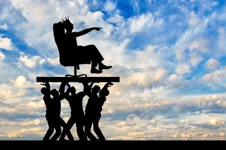 Silhouette of a selfish man with a crown on his head sitting in an armchair, indicates to people who carry him, where to move. The concept of selfish behavior towards other people Stock Photo