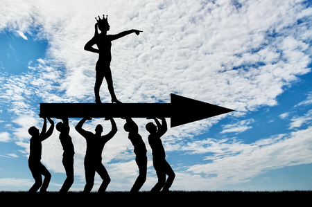 The silhouette of a selfish woman with a crown on her head indicates to the men who carry her, where to move. The concept of selfish behavior towards other people