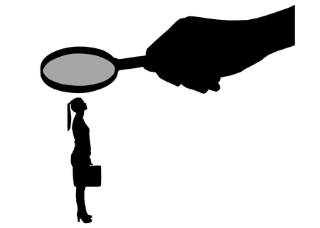 Vector silhouette of an employee woman. A hand with a magnifier over a woman. The concept of gender inequality and prejudice against women workers