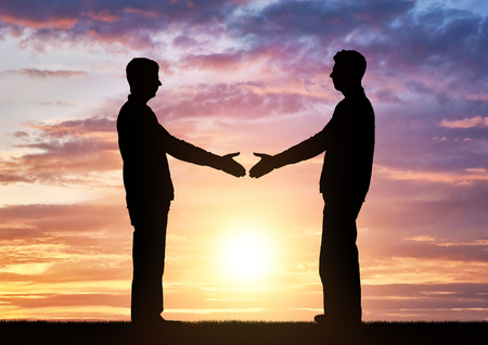 Silhouette two men intend to shake hands. Business concept of business relations
